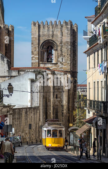 Lisbon - Portugal.  Tram on a busy street in Lisbon city centre. - Stock Image