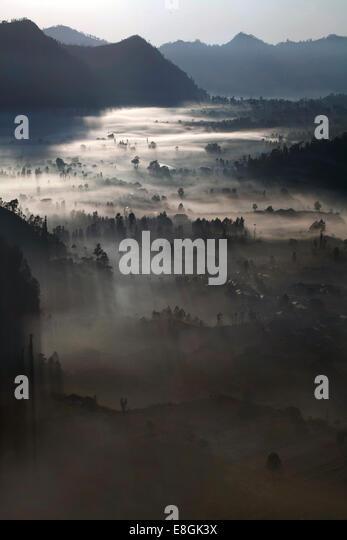 Indonesia, Bali, Kintamani Valley in the morning fog - Stock Image