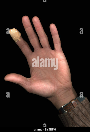 A man with a plaster on his finger, directly below, hand only - Stock Image