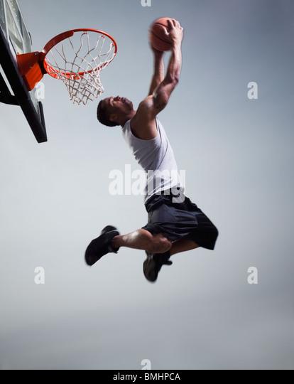 Basketball player jumping - Stock Image
