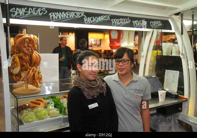 Germany Frankfurt am Main Airport FRA terminal gate area concourse shopping retail display for sale pretzels sausages - Stock Image