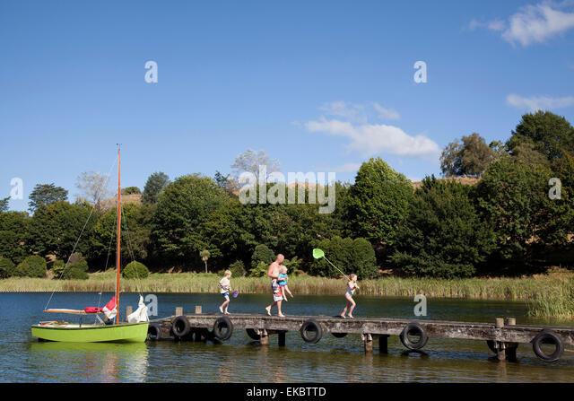 Family walking on pier, Lake Okareka, New Zealand - Stock Image
