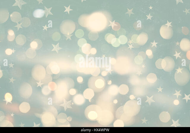 Retro styled Christmas background with bokeh lights and stars - Stock Image