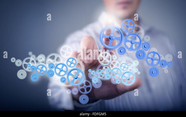 Image of businessman touching gear elements. Mechanism concept - Stock Image