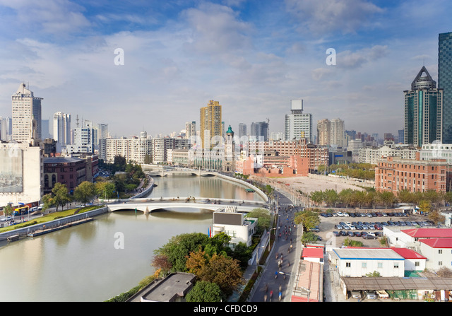 Elevated view along Suzhou Creek, new bridges and city skyline, Shanghai, China, Asia - Stock Image