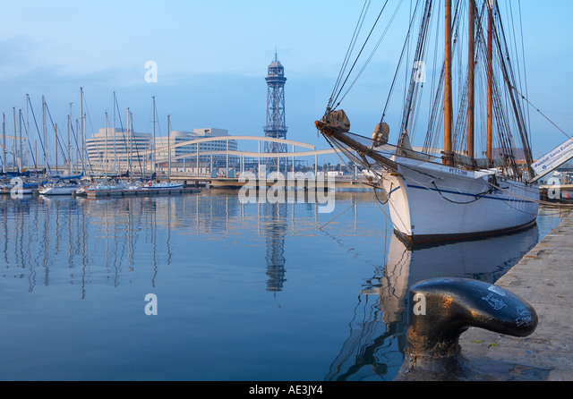 the Old Port area with sailing vessel and swing bridge Barcelona Catalonia Spain - Stock Image