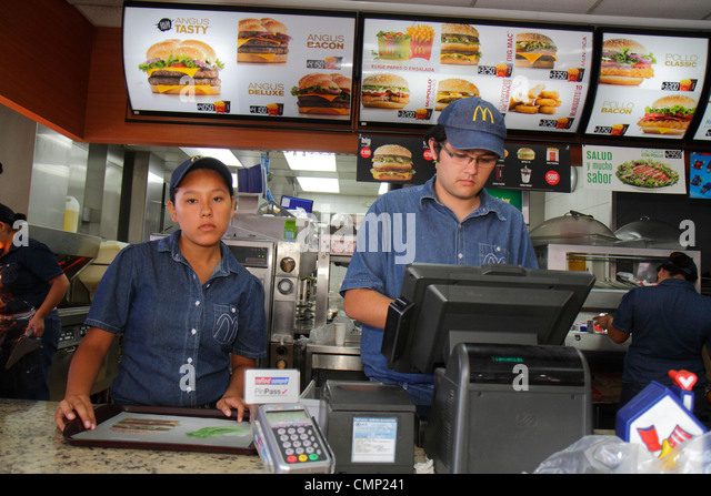 Chile Arica Paseo Peatonal 21 de Mayo pedestrian mall McDonald's fast food restaurant business global company - Stock Image