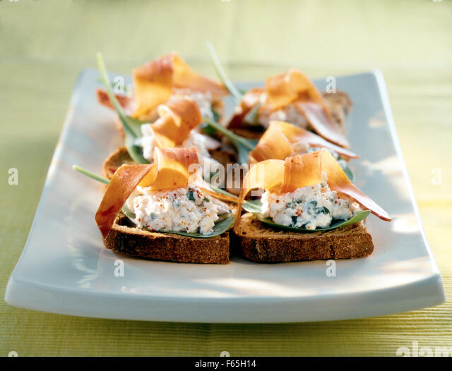 Fromage frais and bayonne ham crostinis - Stock Image