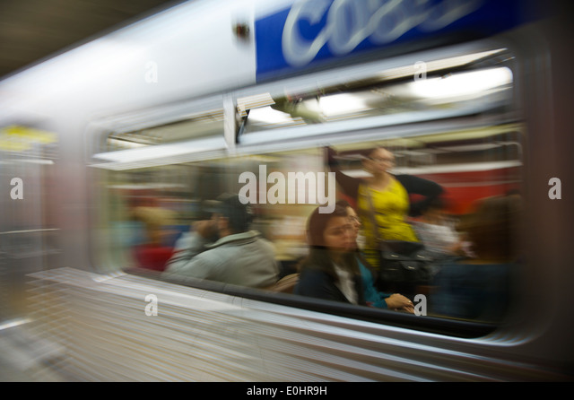 SAO PAULO, BRAZIL - SEPTEMBER 28, 2013: Commuters ride the Metropolitano de Sao Paulo, which carries over 7 million - Stock Image