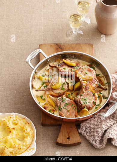 Dish of pork cutlets and apples - Stock Image