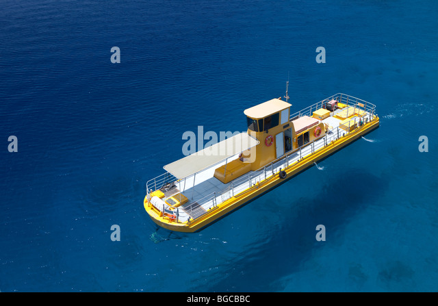 The south of Israel, Eilat city, a yellow boat in the sea - Stock Image