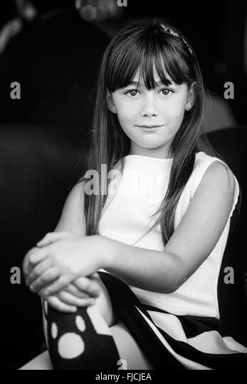 little girl posing as Audrey Hepburn style, decided and sure. - Stock Image