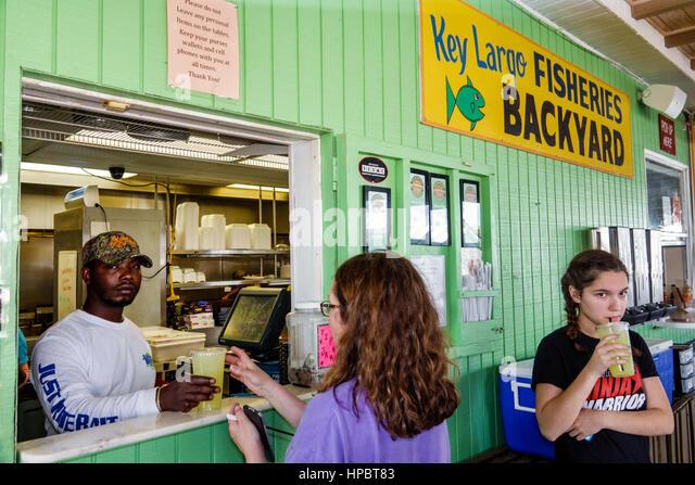 Teenagers eating restaurant stock photos teenagers for Key largo fish market