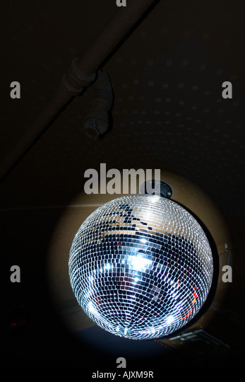 Mirror Ball aka Disco Ball Against a Black Background with Copy Space - Stock Image