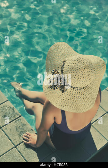 Woman in swimming pool - Stock Image