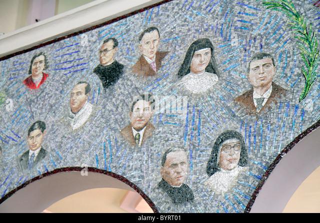 Panama City Panama Calidonia Catholic church exterior mosaic priest nun religion - Stock Image