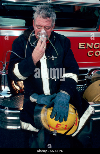 New Jersey Meadowlands East Rutherford fireman oxygen mask air breathing fire fighter - Stock Image