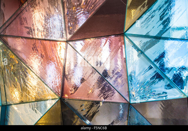 Colorful geometric triangular metallic background texture - Stock Image