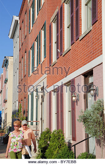 Baltimore Maryland Little Italy ethnic neighborhood working class community row house townhouse man woman couple - Stock Image
