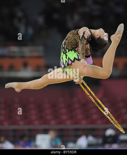 India Delhi 2010 XIX Commonwealth Games Rhythmic gymnastics. Gymnast and hoop. - Stock Image