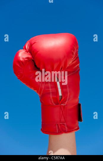 A boxer raises a fist in celebration. - Stock-Bilder