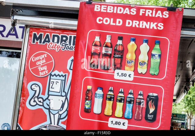 Madrid Spain Europe Spanish Centro Retiro Paseo del Prado bilingual English soft drinks cold water soda Coca Cola - Stock Image
