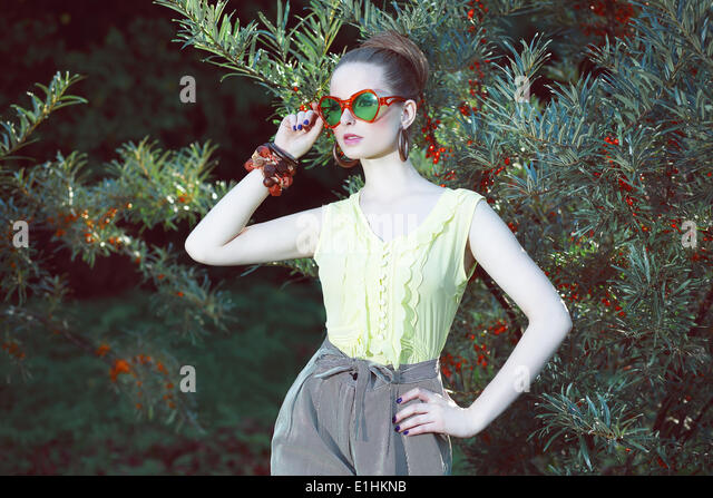Charisma. Individuality. Luxurious Woman in Fancy Sunglasses Outside - Stock Image