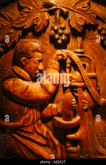chile Colchagua Valley,vina santa cruz vineyard wood carving of man with old wine press, famous wine producing region, - Stock Image