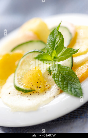 Yellow and white peach salad with mint - Stock Image