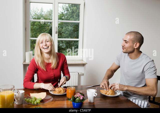 Germany, Berlin, Young couple having breakfast - Stock-Bilder