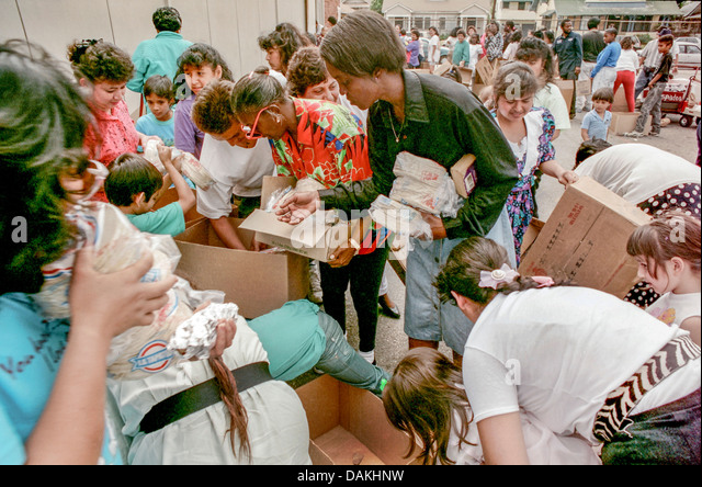 Hungry Hispanic and African American local LA residents fight over free charity food after the 1992 Rodney King - Stock Image