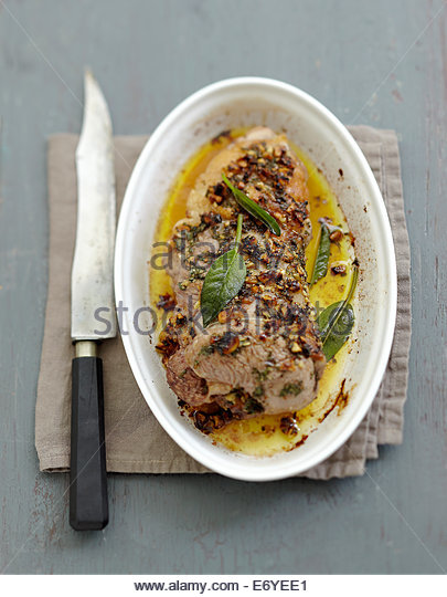 Leg of lamb in sage butter with walnuts - Stock Image