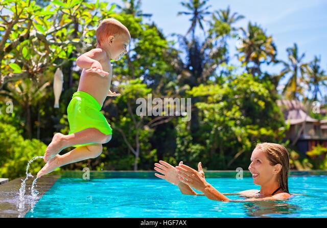 Swimming Pool Action : Children jumping resort swimming pool stock photos