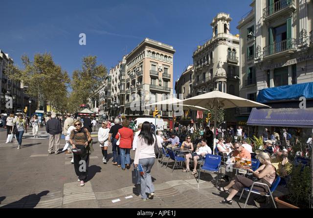 Spain Barcelona Las Ramblas tourists street cafe - Stock Image