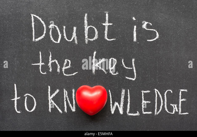 doubt is the key to knowledge phrase handwritten on chalkboard with heart symbol instead of O - Stock Image