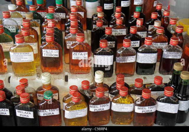 Curaçao Netherlands Antilles Dutch Willemstad Punda Market Waaigatplein New Market shopping bottles coconut - Stock Image