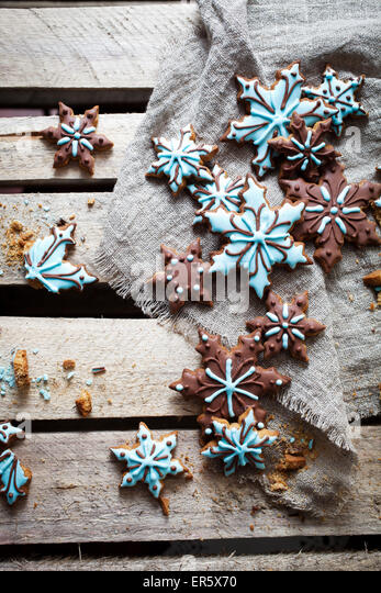Christmas cookies with brown and blue frosting - Stock Image