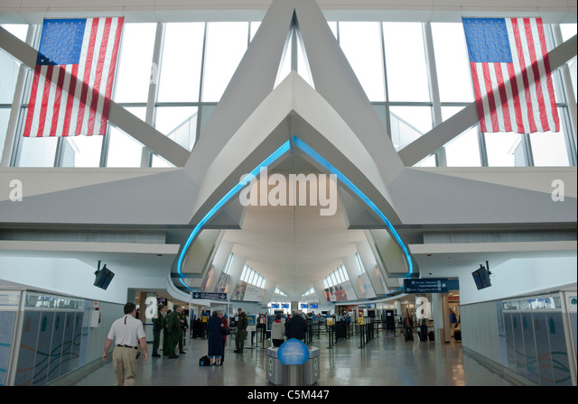 A corridor at the Buffalo Airport resembles the fuselage of an airplane. - Stock Image