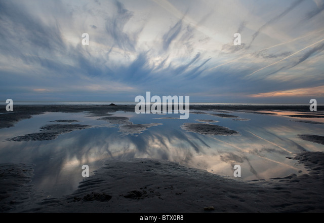 Dramatic sky over beach at Le Touquet, France. - Stock Image