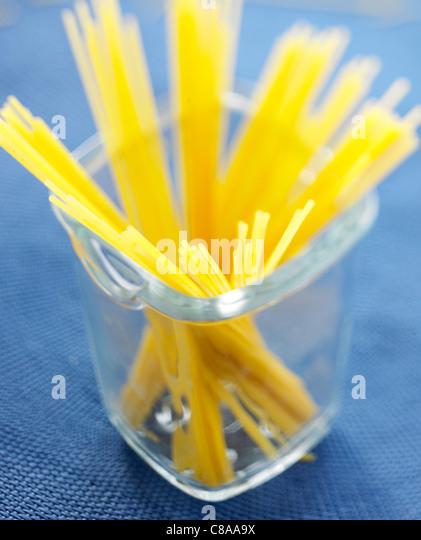 Uncooked spaghettis - Stock Image