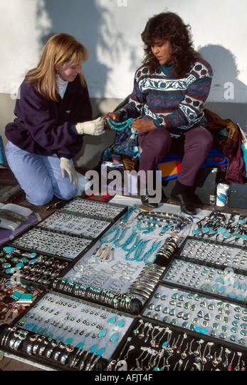 New Mexico Southwest Santa Fe Palace of the Governors Pueblo Native American jewelry vendor visitor NM NM - Stock Image