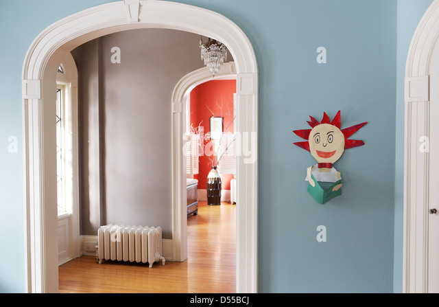 Child's art work hanging in elegant home - Stock Image