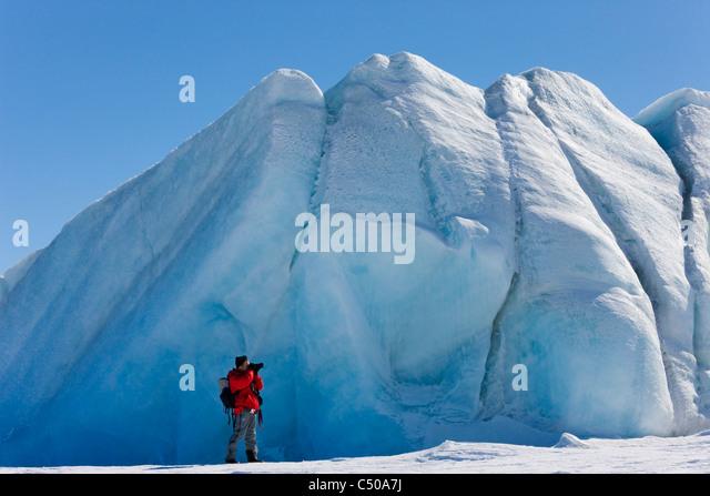 Tourist photographing iceberg, Snow Hill Island, Antarctica - Stock-Bilder