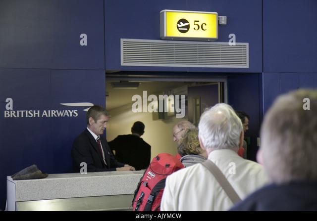 UK, England, London, Heathrow Airport, British Airways, departure gate, passengers, - Stock Image