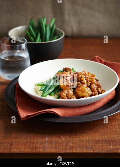 Plate of beef stew with beans - Stock Image