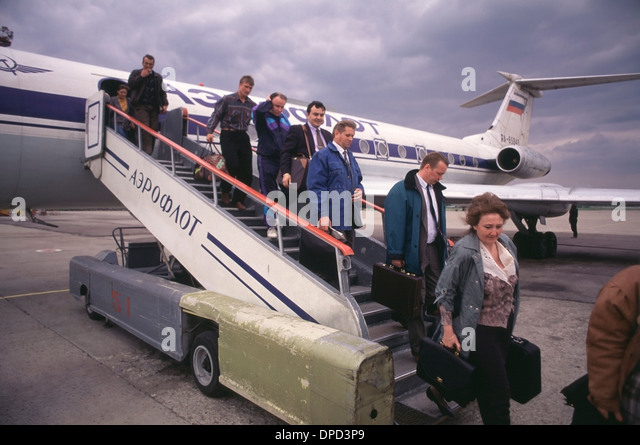 Aeroflot Passengers unload from a Soviet era Tupolev 134 airliner at Vnukovo airport outside of Moscow, Russia. - Stock Image