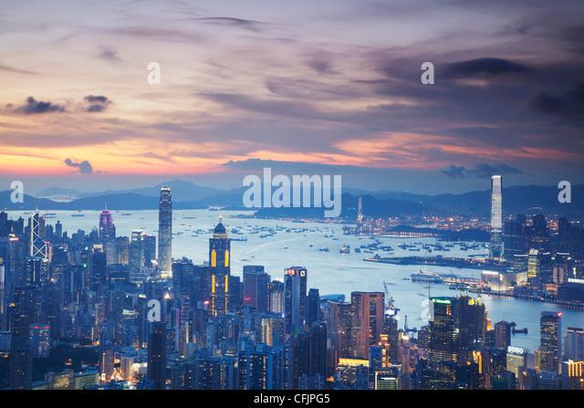 Hong Kong Island and Kowloon skylines at sunset, Hong Kong, China, Asia - Stock Image