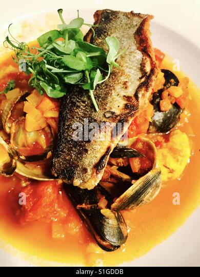 Sea bass with mixed vegetable broth - Stock-Bilder