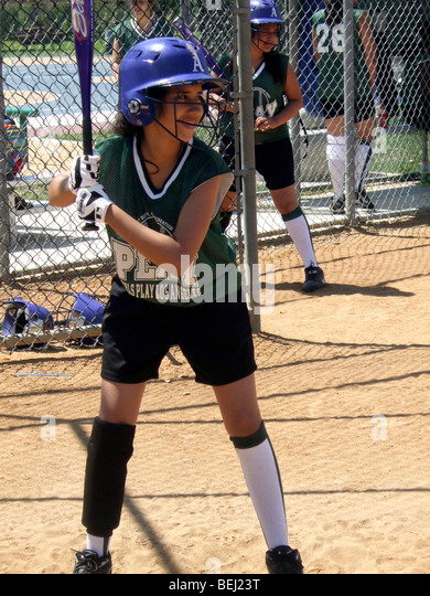 Girl in uniform playing softball - Stock-Bilder