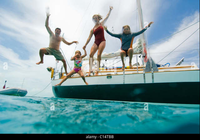 A family jumping off their boat - Stock-Bilder
